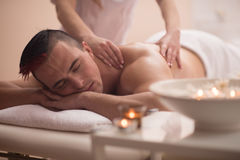 Young man having a back massage Royalty Free Stock Photography