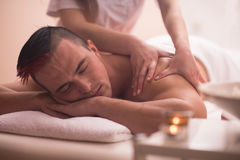 Young man having a back massage Stock Photo