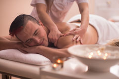 Young man having a back massage Stock Photography