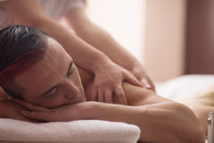 Young man having a back massage Royalty Free Stock Photos
