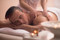 Young man having a back massage Royalty Free Stock Photo