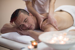 Young man having a back massage Stock Images