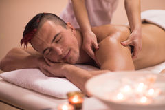 Young man having a back massage Royalty Free Stock Images
