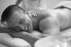 Young man having a back massage Royalty Free Stock Image