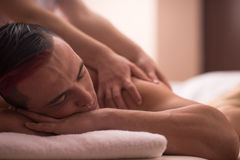 Young man having a back massage Stock Image