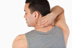 Young man having a back pain Stock Photos