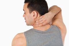 Young man having a back pain Stock Photos
