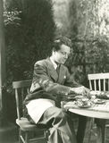 Young man having breakfast at outdoor table Stock Image