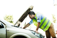 Young man is having car problem. Royalty Free Stock Images