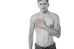 Young man having chest pain Stock Image