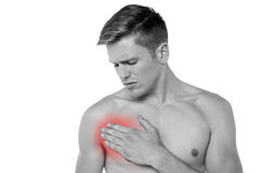 Young man having chest pain Stock Photos