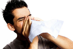 A young man having a cold or allergy. Stock Photo