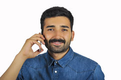 Young Man Having Conversation On Telephone Royalty Free Stock Photo