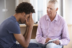 Young Man Having Counselling Session Stock Photos