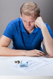Young man having financial problems Stock Image