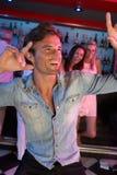 Young Man Having Fun In Busy Bar. Young Man Having Fun Dancing In Busy Bar stock photography