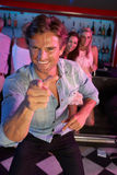 Young Man Having Fun In Busy Bar. Young Man Having Fun Smiling In Busy Bar stock images