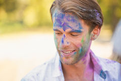 Young man having fun with powder paint Stock Photo
