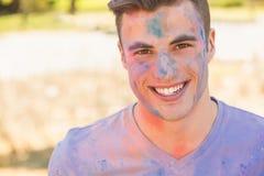 Young man having fun with powder paint Stock Photos