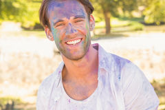 Young man having fun with powder paint Royalty Free Stock Photo