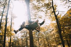 Young man Having fun on a Rope Swing Royalty Free Stock Photography