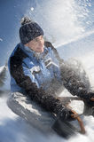 Young man having fun with sled Stock Photos