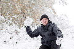 Young man having fun with snow Stock Photography