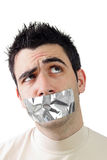 Young man having gray duct tape on his mouth Stock Photos