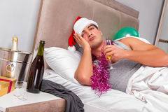 The young man having hangover after heavy partying Stock Photography