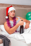 The young man having hangover after heavy partying Royalty Free Stock Photos