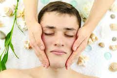 Young man having head massage in the spa salon. Young man, face, having head massage in the spa salon royalty free stock photography