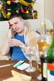 Young man  having headache  after  celebrating Stock Image