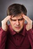 Young man having a headache Royalty Free Stock Photos