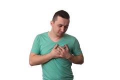 Young Man Having A Heart Attack Stock Photography