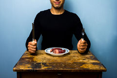 Young man having a heart for lunch Stock Images