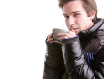 Young man having a hot drink in winter Stock Photo