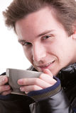 Young man having a hot drink in winter Stock Photography