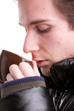 Young man having a hot drink in winter Stock Photos