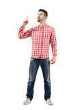 Young man having idea pointing index finger up Royalty Free Stock Images