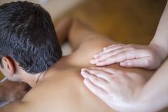 Young man having massage Royalty Free Stock Photo