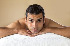 Young man having a massage Royalty Free Stock Photos