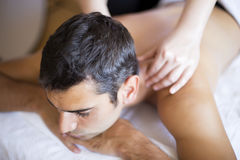 Young man having a massage Royalty Free Stock Photography