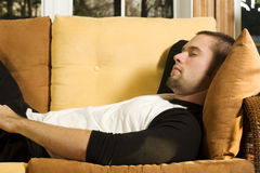 Young man having a nap on couch Royalty Free Stock Photo