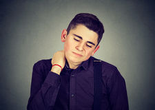 Young man having neck pain Stock Photography