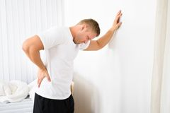 Young man having pain in his back Stock Photography