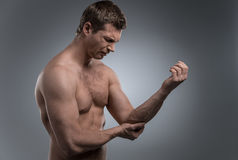 Young man having pain in his elbow. Royalty Free Stock Photography