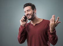 Young man having a phone call Stock Image