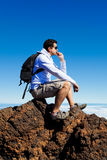 Young Man Having a Rest in a High Peak Over Clouds in Teide Moun Stock Photography