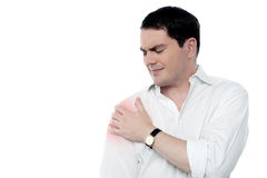 Young man having shoulder joint pain Royalty Free Stock Image