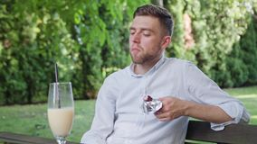 Young Man Having a Snack in the Park Stock Photography